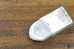 An old white eraser tool for deleting what pencil drawing or wri. Ting on wooden background Stock Photos