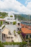 Old white european buildings near marina. Old town of Marmaris with white residential buildings near marina with eautiful mountains at background on sunny day Royalty Free Stock Images