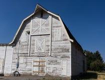 Old white farm barn Stock Photos