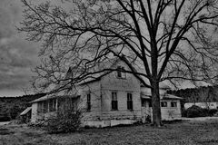 Old White Farm House on Stormy Day Royalty Free Stock Image