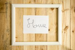 Old white frame Vintage frame with drawings home. On paper wooden background royalty free stock photo