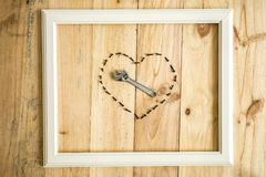 Old white frame Vintage frame with varied tools with heart shape. On wooden background stock images
