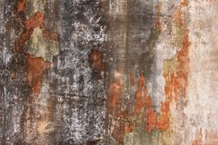 Old white gray damaged concrete wall with scratches and black orange shabby paint. rough surface texture. A old white gray damaged concrete wall with scratches stock photo