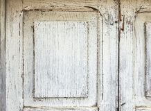 Old White Grunge Painted Wooden Door. Texture Background for Design stock photo
