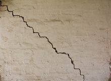 Old white grunge wall with cracks Stock Photography