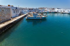 Old white house and Bay in Naoussa town, Paros island, Cyclades, Greece. PAROS, GREECE - MAY 3, 2013: Old white house and Bay in Naoussa town, Paros island Stock Photography
