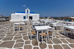 Old white house and Bay in Naoussa town, Paros island, Cyclades, Greece. PAROS, GREECE - MAY 3, 2013: Old white house and Bay in Naoussa town, Paros island Royalty Free Stock Photos