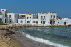 Old white house and Bay in Naoussa town, Paros island, Greece Stock Photos