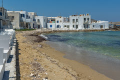 Old white house and Bay in Naoussa town, Paros island, Greece Royalty Free Stock Image