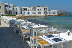Old white house and Bay in Naoussa town, Paros island, Greece Stock Images