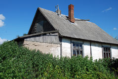 Old white house. Old concrete house with asbestos roof Stock Photography