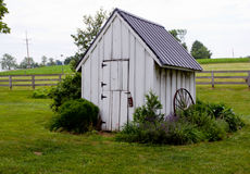 Old white house on farmland Stock Photo