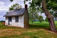 Old white house on farmland Royalty Free Stock Photos