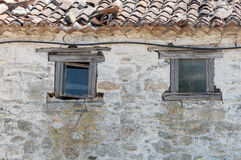 Old white house. With two windows at Agion Oros Stock Photo