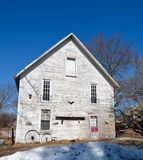 Old White House. This is a Winter picture of an old house in Yorkville, Illinois.  This plain square house was built in 1850.  This picture was taken on March Stock Image