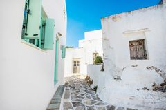 Old white houses with turquoise windows in Lefkes village. Old traditional white houses with turquoise windows in Lefkes village, Paros, Greece royalty free stock images