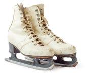 Old white ice skating shoes. And blades isolated on white background - stock image. Vintage ice skates Stock Photography