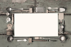 Old white kitchen message sign with cooking utensils for a frame Royalty Free Stock Photo