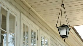 Old white lamp hanging on the ceiling outside stock video footage