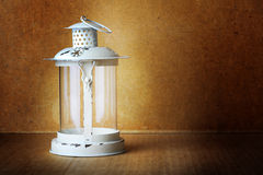 Old white lantern with a mysterious light Stock Photos