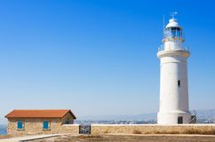Old white lighthouse near the ancient ruins in Paphos Archaeological Park, Cyprus Royalty Free Stock Photography