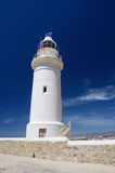 Old white lighthouse near the city of New Paphos ,Cyprus Stock Photos