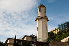 Old White Lighthouse on the Sea Coast in Genoa Stock Photography