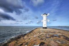 An old white lighthouse in Swinoujscie, Poland. Royalty Free Stock Photos