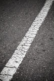 Old white line on te road Royalty Free Stock Photography