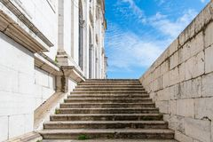 White marble steps climbing to a blue sky stock images