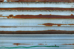 Old white metal fence with rusty spots Royalty Free Stock Photography