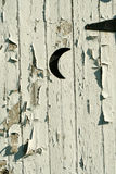 Old white outhouse moon door Royalty Free Stock Image
