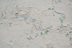 Old white paint. Caps of old paint on a wall Royalty Free Stock Photos