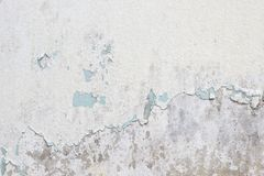 Old white paint texture peeling off concrete wall Stock Photo