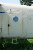 Old white painted aircraft door close up Royalty Free Stock Photo