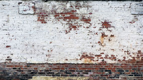 Old White Painted Peeling Brick Wall Stock Images