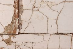 Old painted piece of wood with cracked surface royalty free stock photo