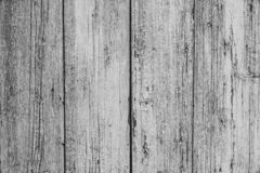 Old white painted rustic fence in vintage style. Retro wood texture background. Gray wooden table. Dirty white wood surface. Old white painted rustic fence in stock photography