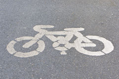 Old white painted sign of bicycle lane Stock Image