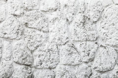 Old white painted wall made of round stones Royalty Free Stock Images