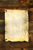 Old white paper clipped on boards background Royalty Free Stock Photo