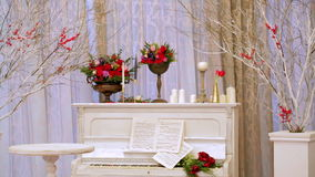 The old white piano with notes and flowers stock video