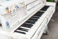 Old white piano is on the street. Old piano is on the old street royalty free stock photos