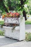Old white piano in a park Royalty Free Stock Images