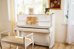 Old white piano in vintage interior Royalty Free Stock Photo