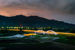 Old white railway bridge in twilight time at Lamphun, Thailand Royalty Free Stock Image