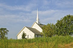Old white rural Lutheran church. A beautiful old country church with a narthex and steeple Royalty Free Stock Images