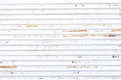 An old white rusty shutter stock image