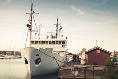 Old white ship moored in port of Kotka. Finland. Vintage toned photo, old style effect Royalty Free Stock Photo