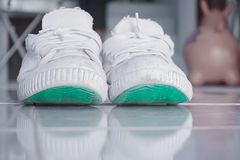 Old white shoes used to play sports. stock photo